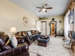 The spacious and airy living room offers high end leather furniture including a recliner!