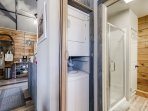 The main bath sits next to a stackable washer and dryer. Supplies are under the bathroom sink!