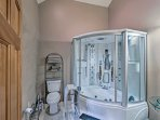 The luxurious en-suite bath includes an enclosed steam shower with a jetted tub combo.