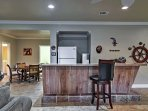 The lower level boasts a bar, living area, and ping pong table.