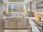 This space features brand new stainless steel appliances and granite counters.