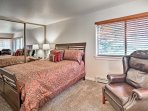 Curl up with a good book on the plush leather chair in the master bedroom.