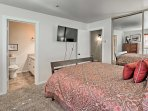 The master bedroom is also equipped with a flat-screen cable TV and en-suite bathroom.