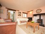 Cosy lounge with a woodburner for those colder days