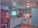 Prepare home-cooked meals with ease in this well-equipped kitchenette.