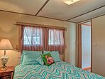 Both bedrooms feature comfortable mattresses with vibrant bedding.