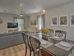 Enjoy meals around the elegant 6-person dining table.