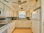 The fully equipped kitchen makes cooking at home a breeze with modern appliances.