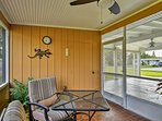When the weather doesn't cooperate, head to the screened-in porch and relax in the 2 chairs.