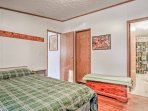 The master bedroom is equipped with a cozy queen bed and an en-suite bath.