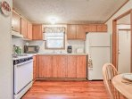 Utilize the updated appliances and ample counterspace featured in the fully equipped kitchen.