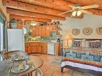 This adobe-style studio features exposed beams and tasteful southwest-inspired decor.