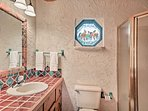 The full bathroom offers a walk-in shower and plenty of counter space to host all your toiletries.