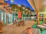 Unwind in one of the many furnished patio areas under the twinkling string lights.