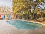 Enjoy access to various shared amenities, including this pristine outdoor swimming pool.