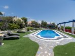 The villa has access to this large communal pool and terrace.