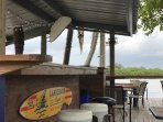 Outdoor Tiki Bar by the pool and restaurant