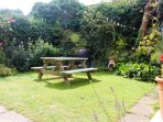 Sunny south facing garden with bbq, lawn and bench