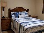 Queen guest bedroom w/ tv and ceiling fan
