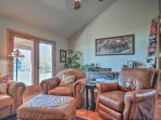 Kick up your feet in the comfortable living area featuring arm chairs facing a gas fireplace and flat-screen cable TV.