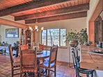 Gather around the 6-person dining table in the living area while admiring the outdoor views framed by the window.