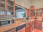 Prepare home-cooked masterpieces in the fully equipped kitchen.