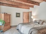 Rest easily in this spacious bedroom featuring a king bed.