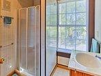 The en-suite bathroom of the master bedroom features a vanity sink and walk-in shower.