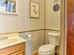 An additional half bath is located on the main level of the home.