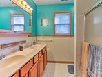 The second full bathroom hosts a double vanity sink and shower/tub combo.