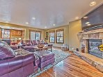 Main Level Great Room with Living Room, Dining Area and Kitchen with Hardwood Floors Throughout