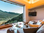 Soggiorno di lusso con accesso al piano superiore dello Chalet