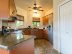 Fully equipped kitchen with every kitchen appliances and utensils needed.