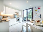 Modern and well-equipped kitchen opens onto balcony
