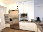 This kitchen is a chef's dream with gas range, viking fridge and double oven.