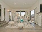 Stunning Designer Living Room - Timothy Othon Cloud Sofa - Noguci table, Doors to Outdoor Balconies