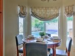Try out your culinary creations at the 4-person dining table next to the kitchen.