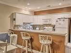 Three guests can sit together at the breakfast bar.