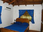 Main Bedroom with a  double and single bed with air conditioning