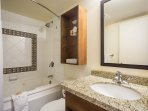 Get ready for the day in the spacious and bright bathroom.