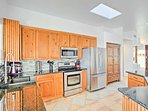 The kitchen boasts stainless steel appliances, granite countertops and plenty of counter space.