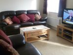 Lounge with 49' Smart TV with Sky Package. Coffee table.