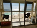 Listen to the waves,  the birds and everyone enjoying the beach life from your enclosed balcony