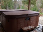 Outdoor hot tub is under a roof ~ no hassle of clearing snow before your relaxing hot soak.