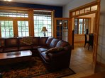 Living room opens to the eat-in kitchen ~ or just close the doors for cozy time with fireplace