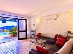 The apartment's spacious lounge leads on to private walled patio on the poolside with amazing views