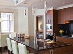 The kitchen has beautiful granite countertops.