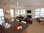 A high ceiling and a large windows make this condo uplifting and bright.