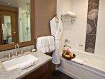 This luxurious bathroom has an incredible rain shower and separate tub.