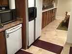 Full size kitchen with dishwasher, fridge and stove.